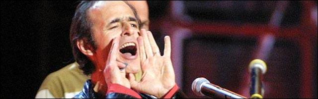 photo concert Jean-Jacques Goldman chanteur Enfoirés